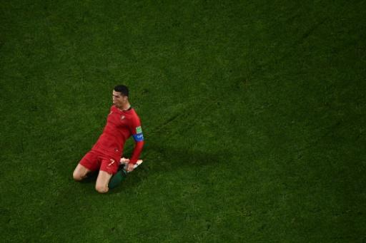 Ronaldo celebrates after scoring one of his three goals against Spain to become only the fourth player to score in four World Cups