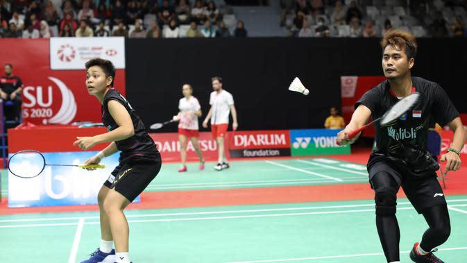 Ganda campuran Indonesia, Tontowi Ahmad/Apriyani Rahayu, saat tampil di Indonesia Masters 2020, Selasa (14/1/2020). (PBSI)