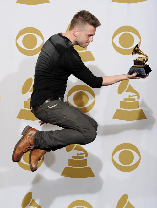 "FILE - In this Feb. 12, 2012 file photo, Ryan Tedder poses backstage with the award for album of the year for ""21"" at the 54th annual Grammy Awards in Los Angeles. The 33-year-old OneRepublic singer and songwriter says his favorite shirts are the ones he bought when was a teenager, and they're from thrift shops. (AP Photo/Mark J. Terrill, File)"