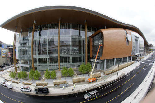 This April 29, 2013, photo made with a fisheye lens shows the Music City Center in Nashville, Tenn. Nashville's new convention center is transforming the look of downtown with its wavy roof dominating six city blocks, but tourism officials hope the eye-catching facility will also show business travelers a revitalized Music City. (A P Photo/Mark Humphrey)
