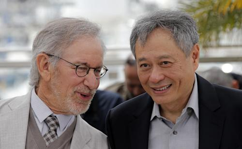 Jury president Steven Spielberg, left, speaks with jury member Ang Lee during a photo call for the jury at the 66th international film festival, in Cannes, southern France, Wednesday, May 15, 2013. (AP Photo/Lionel Cironneau)