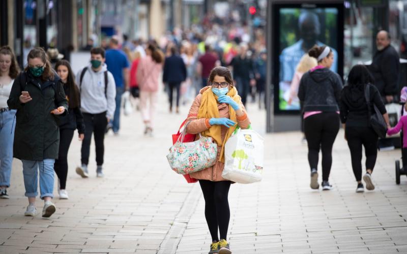 A shopper wears a protective face mask in Edinburgh's Princes Street - PA