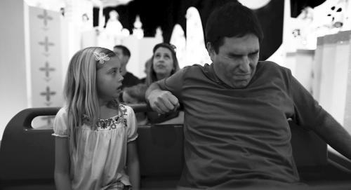 "This undated photo released by Mankurt Media, LLC shows Roy Abramsohn as Jim freaking out during a ride in the amusement park on the last day of his family vacation in a scene from ""Escape from Tomorrow,"" a feature film by writer/director Randy Moore. As an adult, and a filmmaker, Moore wanted to capture and question the allure of manufactured-fantasy theme parks. (AP Photo/Copyright Mankurt Media, LLC)"