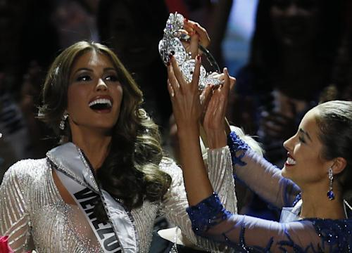 Miss Universe 2012 Olivia Culpo, from the United States, right, places the crown on Miss Venezuela Gabriela Isler during the 2013 Miss Universe pageant in Moscow, Russia, on Saturday, Nov. 9, 2013. (AP Photo/Pavel Golovkin)