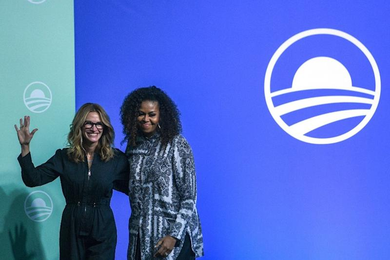 Former US first lady Michelle Obama and US actress Julia Roberts gesture as they arrive to attend an event for the Obama Foundation in Kuala Lumpur December 12, 2019. — AFP pic