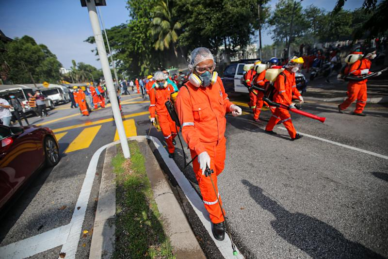 DBKL and Alam Flora personnel sanitise the area around the Sri Petaling Mosque March 28, 2020.