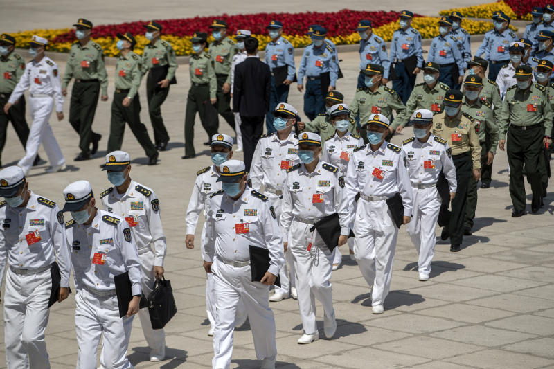 Military delegates arrive for the closing session of China's National People's Congress (NPC) at the Great Hall of the People in Beijing, Thursday, May 28, 2020. China's legislature endorsed a national security law for Hong Kong on Thursday that has strained relations with the United States and Britain and prompted new protests in the territory. (AP Photo/Mark Schiefelbein)