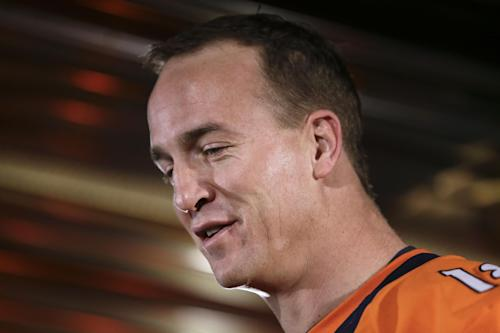 Manning wins 5th MVP award and AP offensive player