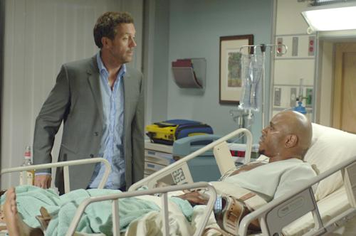 "In this image released by Fox, Hugh Laurie portrays Dr. Gregory House, left, and LL Cool J portrays a sick death row inmate in a scene from ""House, M.D."" The Fox medical drama concludes its eight-season run on Monday, May 21, 2012, with a finale at 9 p.m. EDT, preceded by a one-hour retrospective. (AP Photo/Fox, Jaimie Trueblood)"