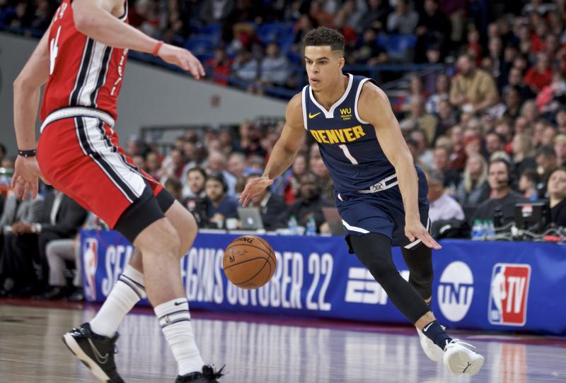 Denver Nuggets forward Michael Porter Jr., right, dribbles toward Portland Trail Blazers forward Mario Hezonja during the second half of a preseason NBA basketball game in Portland, Ore., Tuesday, Oct. 8, 2019. (AP Photo/Craig Mitchelldyer)