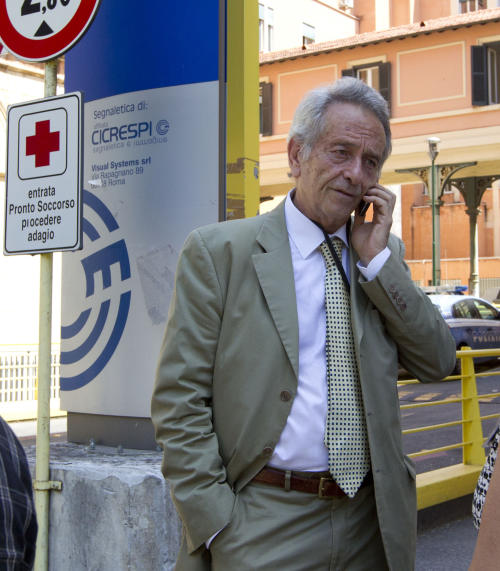 Director Claudio Modini, head of the emergency room at the Policlinico Umberto I hospital, speaks on a mobile phone outside the emergency room entrance of the hosptal, in Rome,Thursday June 20, 2013. Hospital officials said actor James Gandolfini, 51, died after suffering a cardiac arrest on Wednesday while vacationing in Rome. Modini, said Gandolfini arrived at the hospital at 10:40 p.m. (2040 GMT, 4:40 p.m. EDT) Wednesday and was pronounced dead at 11 p.m. after resuscitation efforts in the ambulance and hospital failed. (AP Photo/Alessandra Tarantino)