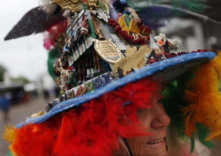 Jinny Keen, from Louisville, Ky., wears a handmade hat, celebrating her 44th Derby appearance before the running of the 139th Kentucky Derby at Churchill Downs Saturday, May 4, 2013, in Louisville, Ky. (AP Photo/David Goldman)