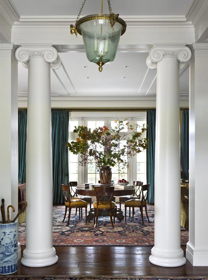 "<p>A stately Virginia home designed by <a href=""https://gpschafer.com/"" target=""_blank"">G.P. Schafer</a> uses branches in an outsized vase to create a statement piece to match the scale of the room.</p>"