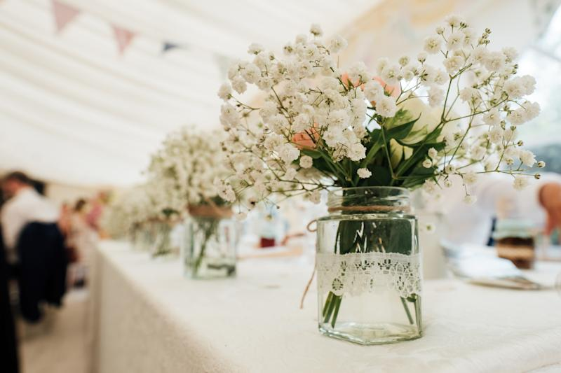 flowers centrepiece and table name with glassware