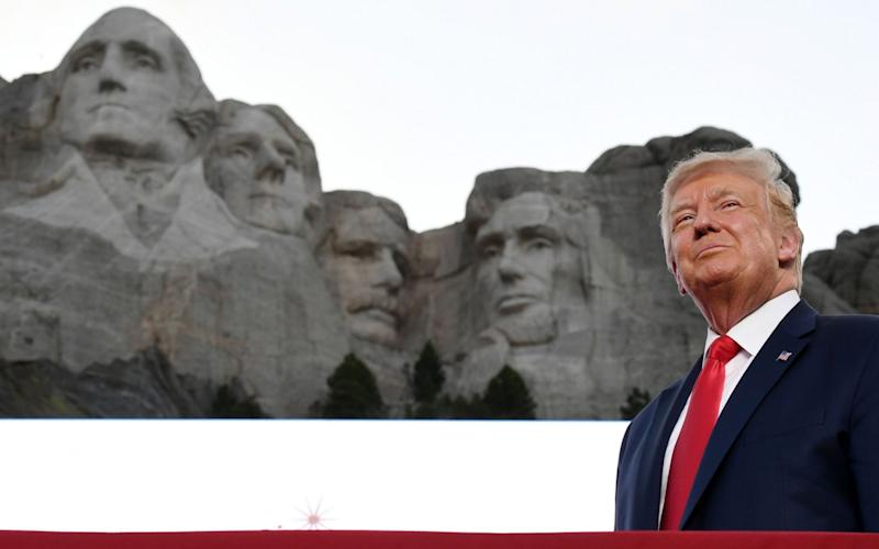 Donald Trump during a speech at Mount Rushmore for July 4 - SAUL LOEB/AFP via Getty Images