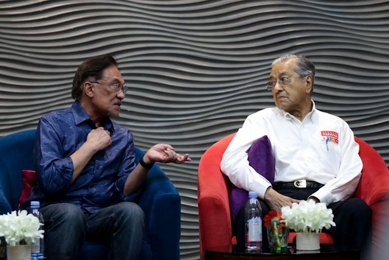 Datuk Seri Anwar Ibrahim speaks to Tun Dr Mahathir Mohamad during PKR's retreat at the Lexis Hibiscus resort in Port Dickson July 19, 2019. — Picture by Ahmad Zamzahuri