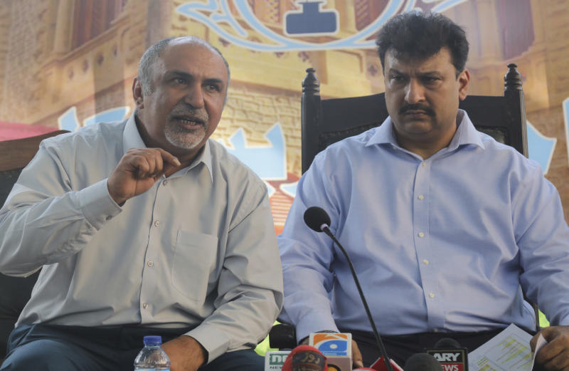 Secretary General Maqsood Bijrani, left, and Captain Chaudhry Salman, President of Pakistan Airlines Pilots' Association address a news conference in Karachi, Pakistan, Saturday, June 27, 2020. A union of Pakistani pilots on Saturday fired back at the country's aviation minister, who claims as many as 262 pilots serving at state-run Pakistan International airlines and other airline companies, obtained licenses to fly planes by having others take exams for them.(AP Photo/Fareed Khan)