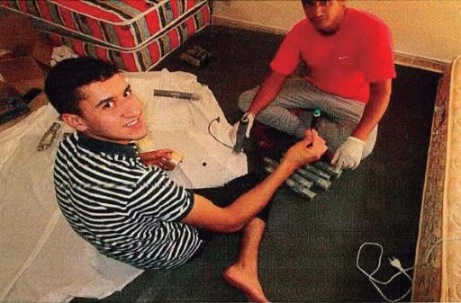 Younes Abouyaaqoub, left, prepares explosives before he drove a van through a crowd in Barcelona, killing 13 people