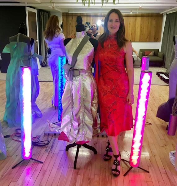 Clare Tattersall poses with some of her creations at the Robotic Dress Exhibition in New York