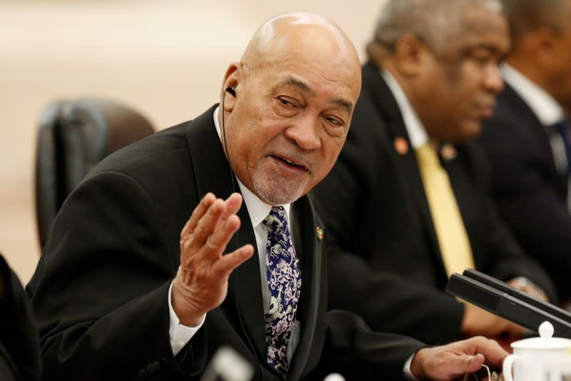 Suriname's President Desi Bouterse attends a meeting at the Great Hall of the People in Beijing