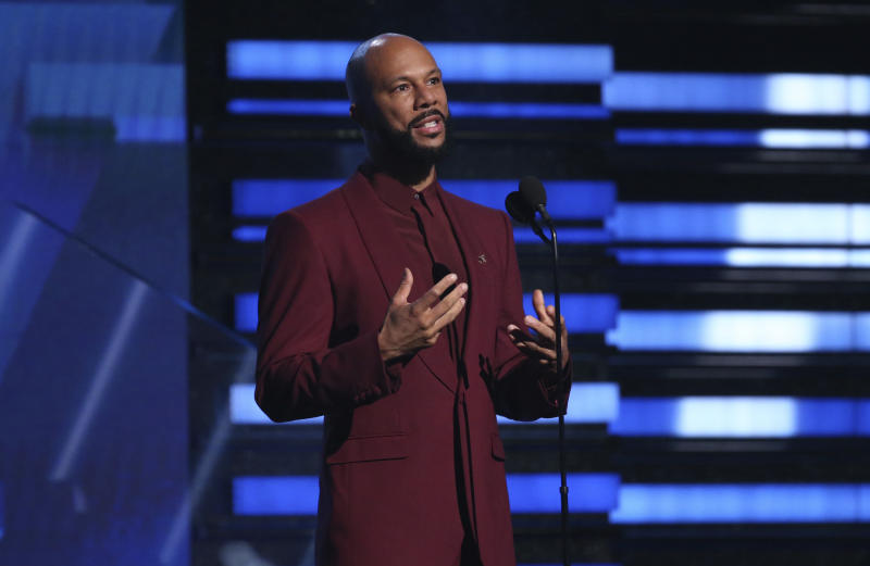 FILE - In this Jan. 26, 2020 file photo, Common introduces a performance at the 62nd annual Grammy Awards in Los Angeles. The Grammy and Academy Award winning rapper and his criminal justice reform organization Imagine Justice has launched a campaign with dozens of advocacy and activist groups calling attention to the threat coronavirus poses on millions of people jailed or imprisoned in the U.S. (Photo by Matt Sayles/Invision/AP, File)