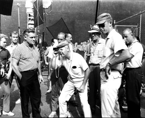 """This 1960 publicity photo provided by MGM shows director, Robert Wise, center, with first assistant director, Robert Relyea, right, on set during the production of the film, """"Westside Story,"""" in New York. Relyea, a film producer and assistant director whose credits included """"The Magnificent Seven,"""" and collaborated with Steve McQueen on several films, including """"Bullitt,"""" """"Le Mans"""" and """"The Reivers,"""" has died. A spokeswoman for Relyea says he died at 82 on March 5, 2013 of natural causes in Los Angeles. (AP Photo/MGM, Courtesy Robert Relyea Collection)"""