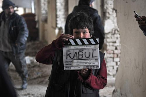 "An undated production still photograph from the Oscar-nominated film, ""Buzkashi Boys,"" which was filmed in Kabul, Afghanistan, shows actor Jawanmard Paiz on the set of the film. Jawanmard Paiz was plucked from the dingy streets of the Afghan capital to be one of the main stars of ""Buzkashi Boys,"" a coming-of-age movie filmed entirely in a war zone and nominated in the Best Live Action Short Film category. (AP Photo/David Gill, Afghan Film Project)"