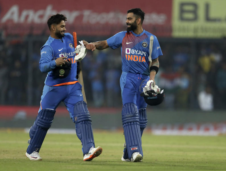 India's captain Virat Kohli, right, and teammate Rishabh Pant celebrate their win in the second Twenty20 international cricket match between India and Sri Lanka in Indore, India, Tuesday, Jan. 7, 2020. India won the match by seven wickets. (AP Photo/Aijaz Rahi)