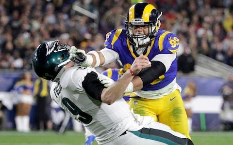 Los Angeles Rams defensive end Aaron Donald hits Philadelphia Eagles quarterback Nick Foles after Foles threw the ball away during the first half in an NFL football game in Los Angeles. The Rams know they've got to pressure Tom Brady early and often to have a chance in the Super Bowl, and they've been assembling the tools for this job all year long. They signed Ndamukong Suh to a big free-agent deal, wrote a record-breaking contract for Aaron Donald and acquired edge rusher Dante Fowler from Jacksonville down the stretch - Credit: AP