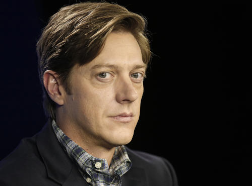 "This June 11, 2013 photo shows actor Kevin Rahm, who portrays Ted Chaough on the television series ""Mad Men,"" in Los Angeles. Rahm's character appeared in a handful episodes in past seasons as the boss of a competing advertising firm. But the recent merger of his and Don Draper's companies _ along with a shocking kiss with Peggy Olson (Elisabeth Moss) _ has thrust Ted to the forefront of the 1960s ad world drama. (AP Photo/Reed Saxon)"