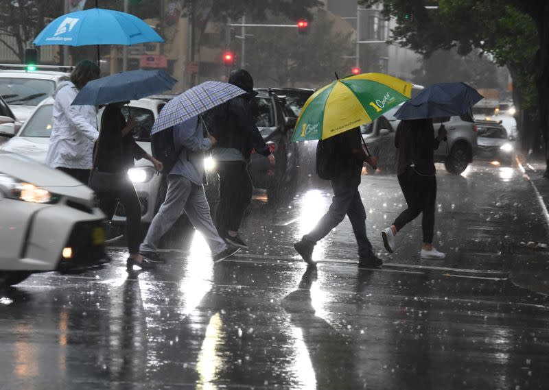 Australia celebrates as heavy rains dampen huge bushfires