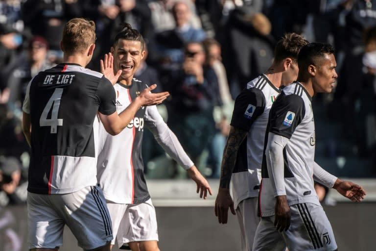 Cristiano Ronaldo (2ndL) has scored in nine consecutive Serie A games