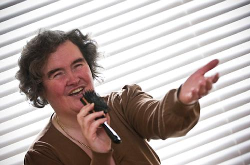 "FILE - In this April 16, 2009 file photo, Susan Boyle, whose performance on the television show ""Britain's Got Talent"" wowed the judges, poses singing with a hairbrush at her home in Blackburn, Scotland. But what happened next for Susan Boyle? The middle-aged church volunteer from a small town in Scotland became an instant global celebrity in 2009 with her heart-stopping rendition of the ""Les Miserables"" number ""I Dreamed a Dream"" on a TV talent show. A week is a long time in showbiz _ and in our hyper-speed online age three and a half years is an eternity _ but Boyle is still going strong. She has sold millions of records, received an honorary doctorate, sung for Pope Benedict XVI and performed in Las Vegas. A stage musical about her life has played to enthusiastic crowds across Britain and is headed for Australia, and next month she releases her fourth album, ""Standing Ovation."" (AP Photo, File)"