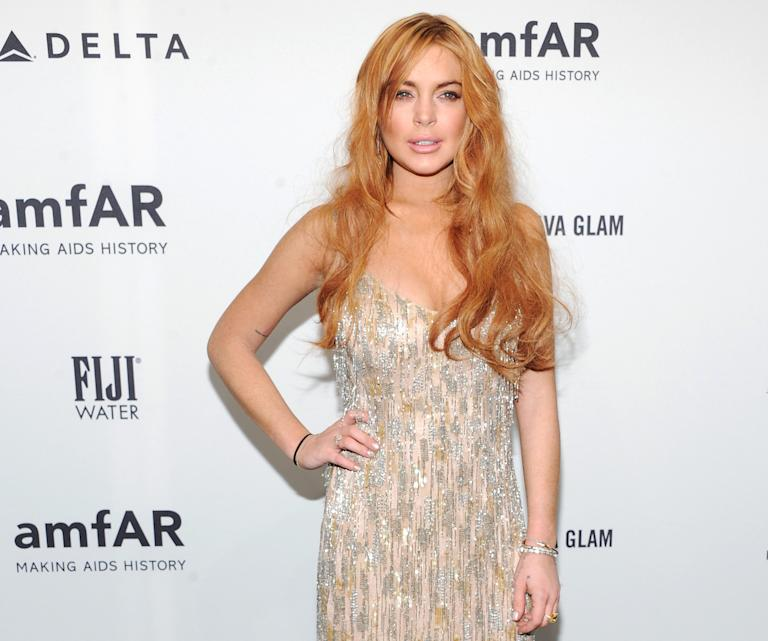 FILE - In this Feb. 6, 2013 file photo, actress Lindsay Lohan attends amfAR's New York gala at Cipriani Wall Street in New York.  Lohan is due back in court on Monday March 18, 2013 for a hearing that will lay out when her trial will begin on misdemeanor charges she lied to police and was driving recklessly when her sports car crashed in June 2012. Lohan's trial is scheduled to begin this week, but her attorney has previously sought a delay. (Photo by Evan Agostini/Invision/AP, File)