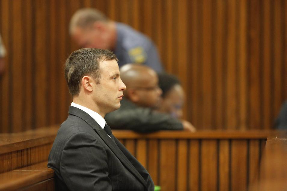 Oscar Pistorius listens in the dock in Pretoria, South Africa, Thursday Sept. 11, 2014 as Judge Thokozile Masipa reads notes as she delivers her verdict in Pistorius' murder trial. The verdict is expected to take hours and possibly two days to present. She will decide with the help of two legal assessors if Pistorius is guilty of the murder of his girlfriend Reeva Steenkamp. (AP Photo/Kim Ludbrook, Pool)