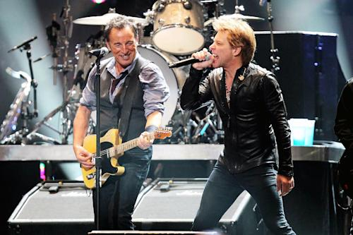 In this image released by Starpix, Bruce Springsteen, left, and Jon Bon Jovi perform during 12-12-12 The Concert for Sandy Relief at Madison Square Garden in New York on Wednesday, Dec. 12, 2012. Proceeds from the show will be distributed through the Robin Hood Foundation. (AP Photo/Starpix, Dave Allocca)