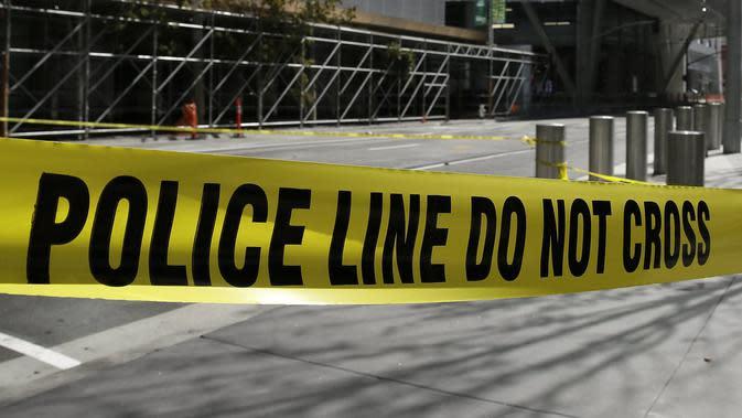 Ilustrasi garis polisi (AP/Eric Risberg)