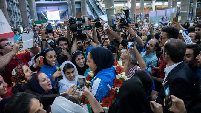 Kimia Alizadeh menjadi wanita Iran pertama yang berhasil merebut medali di ajang Olimpiade (peyman / ISNA / AFP)
