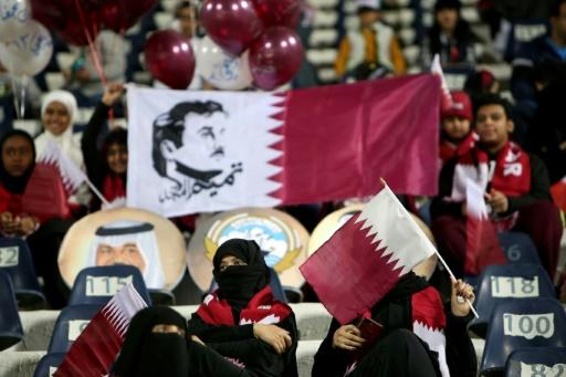 A this file picture taken on December 23, 2017 shows supporters of the Qatar national football team waving their national flags at a Gulf Cup of Nations match against Yemen in Kuwait City