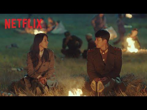 """<p>Led by mega-stars Hyun Bin and Son Ye-Jin, <em>Crash Landing </em>tells the story of South Korean heiress Yoon Se-ri, who finds herself stranded in North Korea after a freak paragliding accident. Enter: Captain Ri Jeong Hyeok, the handsome but stoic North Korean soldier who finds Se-ri and (surprise!) falls in love with her. With plenty of twists, turns, and rom-com tropes, writer Park Ji-eun weaves a compelling story of star-crossed lovers, backed by Bin and Ye-Jin's powerful chemistry and a charming supporting cast. The drama became a global hit and is currently the <a href=""""https://www.kdramapal.com/crash-landing-on-you-becomes-2nd-cable-drama-hit-20-tv-rating/"""" target=""""_blank"""">second-highest rated</a> show in Korean cable TV history.</p><p><a class=""""body-btn-link"""" href=""""https://www.netflix.com/watch/81205759"""" target=""""_blank"""">WATCH NOW</a></p><p><a href=""""https://www.youtube.com/watch?v=GVQGWgeVc4k"""">See the original post on Youtube</a></p>"""