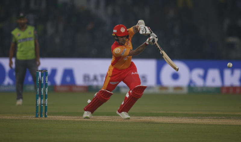 Luke Ronchi of Islamabad United hits boundary against the Lahore Qalandars during a Pakistan Super League T20 match in Lahore, Pakistan, Wednesday, March 4, 2020. (AP Photo/K.M. Chaudary)