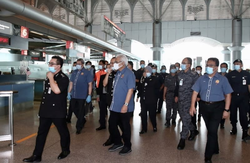 Home Minister Datuk Seri Hamzah Zainudin (centre) during his visit to the Bangunan Sultan Iskandar building that houses the customs, immigration and quarantine (CIQ) facility in Johor Baru, April 7, 2020. — Picture by Ben Tan