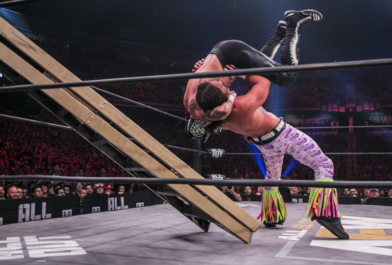 """The Young Bucks are seen during their match against the Lucha Bros. at All Elite Wrestling's """"All Out"""" event in August. (Photo by James Musselwhite/Courtesy of AEW)"""