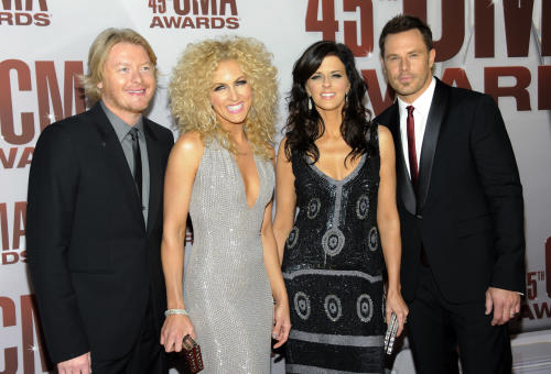"FILE - In a Nov. 9, 2011 file photo, from left, Phillip Sweet, Kimberly Schlapman, Karen Fairchild and Jimi Westbrook of Little Big Town arrive at the 45th Annual CMA Awards in Nashville. Little Big Town co-wrote and recorded the theme song for ABC's new show ""Good Afternoon America."" (AP Photo/Evan Agostini, file)"