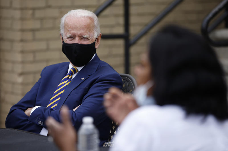 Democratic presidential candidate, former Vice President Joe Biden, left, listens as Carlette Brooks, owner of Carlette's Hideaway, a soul food restaurant, talks during a meeting with small business owners, Wednesday, June 17, 2020, in Yeadon, Pa. (AP Photo/Matt Slocum)