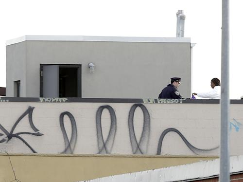 """CORRECTS TO CLARIFY RELATIONSHIP BETWEEN SHOOTER AND VICTIMS - Police officers and crime scene personnel work on the roof of a building in the Brooklyn section of New York, Monday, Nov. 11, 2013. A musician shot and killed two members of an Iranian indie rock band, the Yellow Dogs, and a third musician early Monday, and wounded a fourth person at their apartment before killing himself on the roof, police and the group's manager said. The shooter was a member of another band from Iran, the Free Keys, who knew the victims but hadn't spoken to them in months because of a """"petty conflict,"""" according to Yellow Dogs manger Ali Salehezadeh. (AP Photo/Seth Wenig)"""