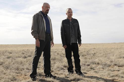 "This image released by AMC shows Bryan Cranston as Walter White, left, and Aaron Paul as Jesse Pinkman in a scene from the season 5 premiere of ""Breaking Bad."" The program was nominated for an Emmy award for outstanding drama series on Thursday, July 19, 2012. The 64th annual Primetime Emmy Awards will be presented Sept. 23 at the Nokia Theatre in Los Angeles, hosted by Jimmy Kimmel and airing live on ABC. (AP Photo/AMC, Ursula Coyote)"