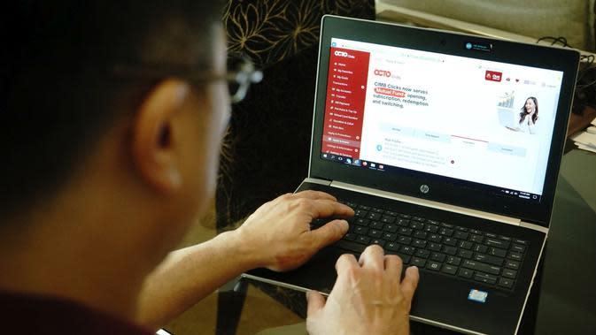"""CIMB Niaga menyempurnakan layanan internet banking """"CIMB Clicks"""" menjadi """"OCTO Clicks"""". (Cok CIMB Niaga)"""