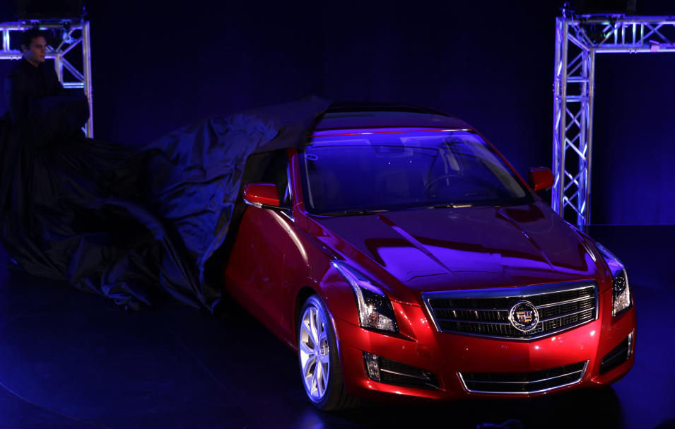 The 2013 Cadillac ATS is unveiled prior to the North American International Auto Show in Detroit, Sunday, Jan. 8, 2012. (AP Photo/Paul Sancya)