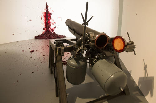 The art work 'Shooting Into The Corner' by Indian Artist Anish Kapoor is displayed at the exhibition 'Kapoor In Berlin' in the Martin-Gropius-Bau museum in Berlin, Friday, May 17, 2013. The exhibition will run from May 18, until Nov. 24, 2013. (AP Photo/Markus Schreiber)